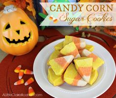 Easy & fun Candy Corn Sugar Cookies!! at ALittleClaireification.com #Recipe #Halloween #Cookies