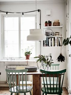 Windsor chairs are already so popular, but forest green Windsor chairs! I'm in love.