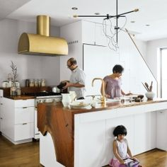 Beautiful modern kitchen with white, wood and brass elements.