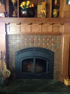 Isn't this cozy? Craftsman style handmade tile from North Prairie Tileworks make this fireplace surround a true classic. See more at http://handmadetile.com/index.html