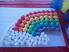 cupcakes arranged in the rainbow color and shape with marshmallow clouds...easy and cute