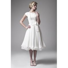 1950s wedding dress with bateau neckline and cap sleeves. Flowing chiffon adds this vintage design gentle touch. Free made-to-measurement service for any size. Available colors seen as in Color Options.