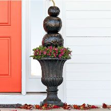 Paint your pumpkins black for a beautiful yet spooky entryway!