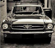 Black shiny Ford Mustang 1965
