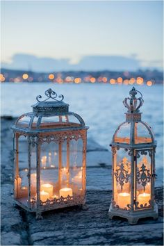 Plan to use a ton of these at the wedding--Wrought Iron Lanterns Filled with Candles Lantern Lamp, Candle Lanterns, Lantern Centerpieces, Wedding Centerpieces, Decoration Entree, Vintage Lanterns, Classic Lanterns, Rustic Lanterns, Bird Cages