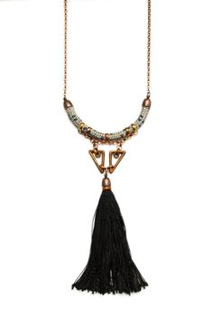 A long and elegant rope necklace with oxidized triangle shaped metal beads and a large black tassel.  - hand dyed nylon rope - cotton and polyester