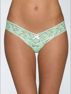 Lowrise Thong in Gingham Green by Hanky Panky at Pesca Trend. Hanky Panky's signature lace thong sits lower on the hips. The world's most comfortable thong features a flattering V waistband. Offers no visible panty line. Thong provides minimal coverage in the back. Available in green. Body made from 100% nylon, trim from 90% nylon and 10% spandex, and lining made from 100% cotton in the USA by Hanky Panky.