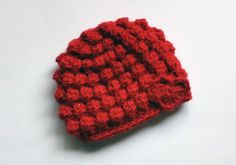 Hey, I found this really awesome Etsy listing at https://www.etsy.com/listing/176525105/red-bobble-crochet-baby-hat