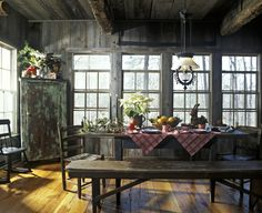 Checkered tablecloths, white poinsettias and weathered barnwood.