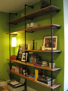 DIY Pipe Shelving.  Some version of this for the new house, (minus the poison green walls).