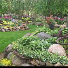 Rock walls ...around veggie garden and electric pole