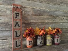 This Mason Jar Fall Decor is just a bundle of rustic warmth!! Add this adorable set of mason jars to your fall decor or gift it to a loved one, co-worker, etc...  SIZE & DESCRIPTION: Fall Mason Jars - Set of 4 decorative pint size mason jars. The mason jars have been hand painted with mustard, burnt umber, burnt orange and a warm burgundy acrylic paint, slightly distressed. Weve wrapped the jars with burlap, which we hand painted the letters F.A.L.L., one letter per jar. Weve added a twine…