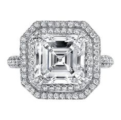 Double halo engagement ring with asscher cut center stone.