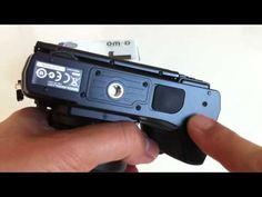 Olympus OM-D E-M5 Battery Grip HLD-6 Detailed Look and Setup [by Giulio Sciorio on YouTube]