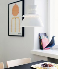 Artek | Pendant Lamp U336 https://www.surrounding.com.au/artek/pendant-lamp-u336/ Artek Pendant U336 The U336 Lamp by Artek is made of white painted steel. The slim neck of the lamp has an additional collar for the light to shine out of it as well. Both light sources and the innovative design of the U336 pendant lamp will enrich every home. The Artek Pendant U336 was designed by Jørn Utzon.