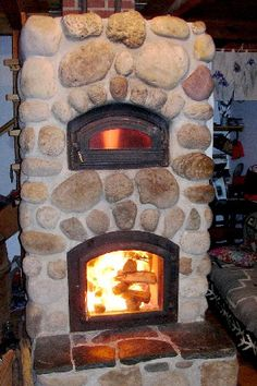 This is a masonry stove; a wood burning stove that is super efficient. It can also come with a bake oven. Homemade pizza and bread, anyone?