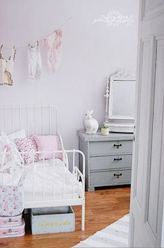 Beautiful kids space - esp love the bunny lamp, grey pain and floral touches - kinda Cath K ish.
