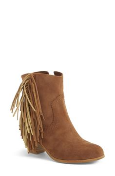 Crushing on these fringe booties.