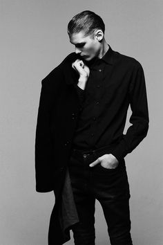 Piotr Suchecki by Angelika Rogozinska. The black button up, trench coat, and slicked back hair- I like it.