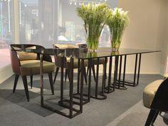 New Kos dining table with Ebony veneer and black nickel base, smoked grey glass top