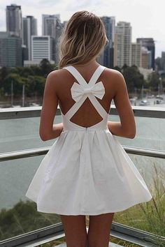 Criss cross white dress with bow