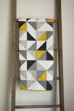 Modern quilt inspiration: CHEVRON THROW.  And the blanket ladder is a perfect way to display and make handy.  We do sit on our quilts, don't we, Mary Ellen