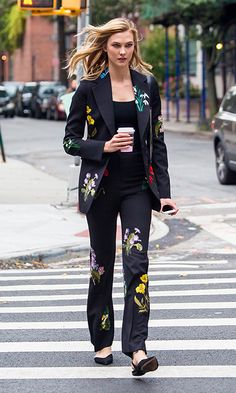 Karlie Kloss made a floral statement stepping out in New York City wearing a black pantsuit that featured colorful flower prints.