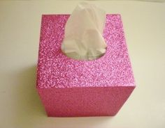 Cover your tissue box w/ style and sparkle! This fine glitter tissue box cover gives a sparkling touch to the bathroom, bedroom, office or anywhere. The decorative fine glitter surface also comes in a variety of colors! The glitter is in the glitter stock surface, so theres no loose glitter. The base is made out of smooth solid paper mache. The inside is hand painted with matching non toxic acrylic paint. It has an open bottom to fit right over any standard square tissue box. Measures 5 ...