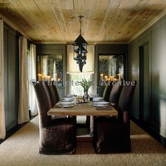 Custom made mirrors have been treated to look antique and contribute to the texture of the dining room