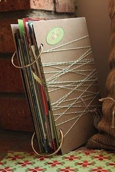 Bind together wedding cards like a scrapbook! I absolutely love this idea because I love saving cards but they just get thrown in a pile. This is such a cute idea! :)