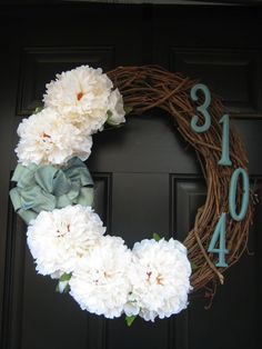 DIY Grapevine Wreath REVIEW: Instead of the addess, I did a monogram and put on some springtime colored flowers. All total: $20 at Michaels. Flowers on sale, monogram in the clearance aisle, and used a coupon for the wreath. Perfect!