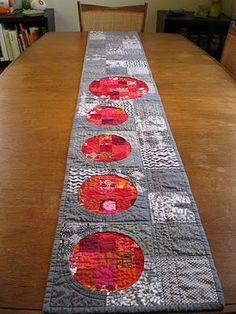 quilted table runner in gray and vibrant red.
