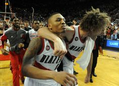 PORTLAND, OR - MAY 2: Damian Lillard #0 of the Portland Trail Blazers celebrates with Robin Lopez #42 of the Portland Trail Blazers after hitting a last second shot to win the game in the fourth quarter of Game Six of the Western Conference Quarterfinals against the Houston Rockets during the 2014 NBA Playoffs at the Moda Center on May 2, 2014 in Portland, Oregon.