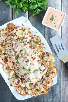 These Reuben-Topped Irish Nachos feature seasoned, oven-baked potato chips, plus delicious toppings loaded with the ever-popular flavors of a reuben sandwich! Easy to make, seriously delicious!   www.TwoHealthyKitchens.com