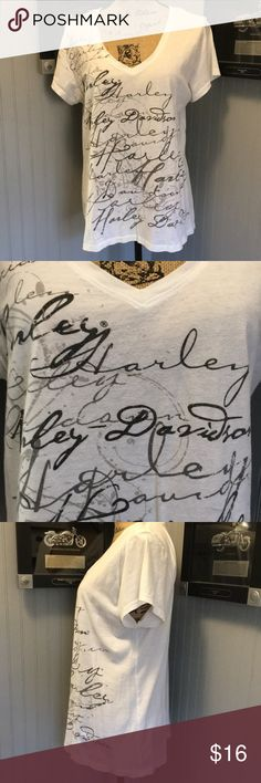 "Harley Davidson V-Neck T-Shirt EUC. A pretty white tee with Harley Davidson all over the front. Dealership name on back. Length 24"". Armpit to armpit 21"" Harley-Davidson Tops Tees - Short Sleeve"
