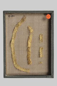 Viking EmbroideryMade of golden thread and originally fastened on textiles.Grave find, Björkö, Adelsö, Uppland, Sweden.