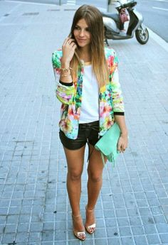 White blouse with colorful cute skirt and black leather skirt and bright caribbean green leather clutch and cute high heels pumps