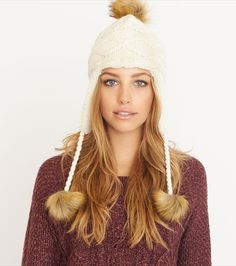 You da pom girl! Stay cozy and all kinds of stylish in this must-have beanie. It features a super soft interior and faux fur pompons.