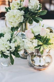 Style Me Pretty wedding table centerpieces silver tea and coffee pots