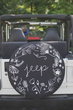 Add some artwork to your tire cover.   36 Things That Will Make Riding In Your Car So Much Better
