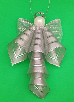 Use the Bowdabra to make this quick, easy and oh so beautiful angel bow ornament for your tree or use to decorate packages, hang in a foyer and more