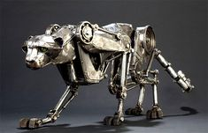 "This Steampunk Mechanical Cheetah by Mechanical Cheetah, is Cool.  ""The cheetah measures 24"" high and 50"" nose to tail and weighs about 40 pounds. She took about 60 hours, spaced over 10 weeks time, to build. She's constructed out of the usual electrical conduit, transmission parts, and 20-gauge steel."