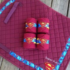 Custom superman polo wraps and English saddle pad  www.whinneywear.com www.facebook.com/whinneywear