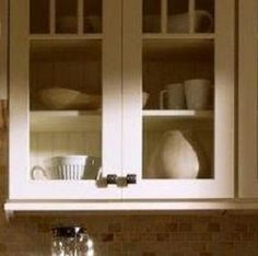 Beadboard Back -- We will line a glass-door or open cabinet with beadboard for a subtle touch of style.
