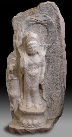Figurines of intrigue.  Carved Stone Kwan Yin