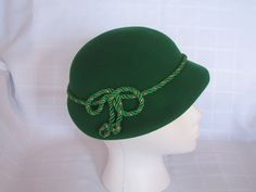 The perfect hat for a blustery bus-ride: 1930s 1940s Green Wool Vintage Womens Cloche Hat Narrow Brim Green & Gold Braid Henry Pollak Glenover Near Mint Condition. $48.00, via Etsy.