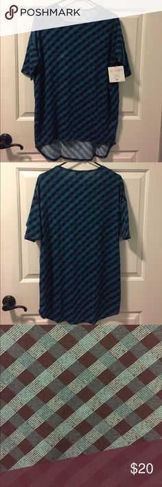 LuLaRoe Irma XS Navy Teal Aqua Lattice Plaid Print LuLaRoe Irma XS Navy Teal Aqua Lattice Plaid Print. Brand new with tags. Has a light spot in the aqua part of the plaid on the front. It was like that when I got it but didn't notice right away. Might come out when washed. Close up in last photo. 96% polyester, 4% spandex. LuLaRoe Tops Tunics