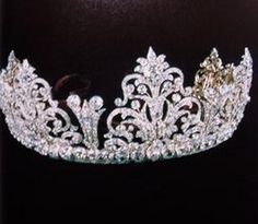 Diamond tiara, belonging to the Percys of Northumberland. Designed as at least five large foliate and scroll motifs, with smaller diamond spacers. This other tiara came in use during the Coronation of Elizabeth II when it was worn by Duchess Helen's daughter-in-law, Elizabeth, nee Montagu Douglas Scott. See next pins.