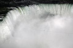 Nik Wallenda tightroped over Niagara Falls on a 2-inch-wide wire. He's the first person to ever cross directly over the falls from the U.S. into Canada.  (by Frank Gunn / AP)