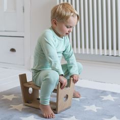 STOOL is a scooter turned upsid down - here in white oiled solid oak